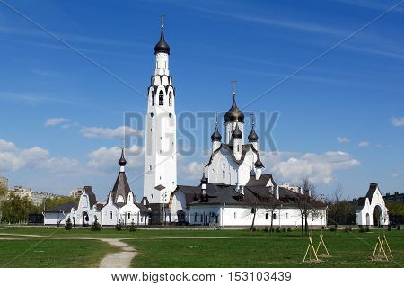 SAINT PETERSBURG RUSSIA - MAI 07 2014: a Church of St Peter the Apostle in the middle of a park in St. Petersburg