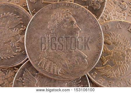 Vintage background ruble silver coin 1729 Russian emperor Peter II Autocrat of all Russia