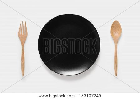 Design Concept Of Mockup Black Dish, Wood Spoon And Wood Fork Set Isolated On White Background. Copy