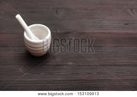 Cup For Sake With Spoon On Dark Brown Wooden Table