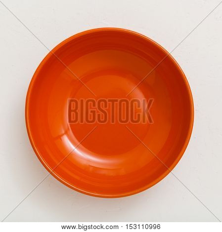 Above View Of Orange Bowl On Plastering Plate