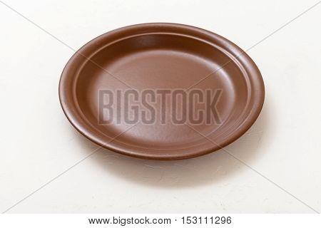 Brown Plate On White Plastering Board