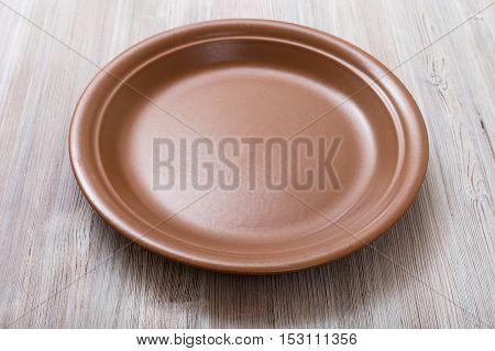 Brown Plate On Gray Brown Table