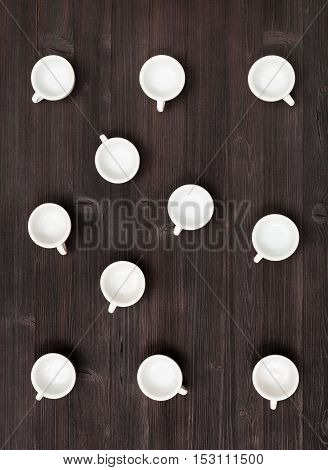Top View Of Many White Cups On Dark Brown Table