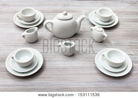 Cups With Saucers And Tea Set On Gray Brown Board