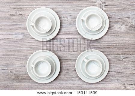 Top View Of Four Cups And Saucers On Gray Table
