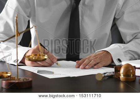 Notary public in office signing document