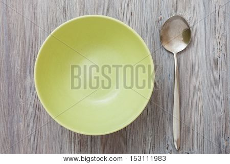Top View Of Green Bowl And On Gray Brown Tabl