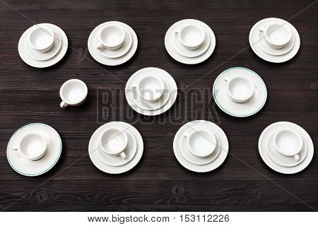 Above View Of Cups And Saucers On Dark Brown Board