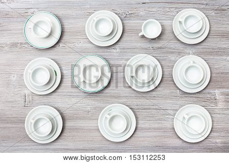 Top View Lot Of Cups And Saucers On Gray Board