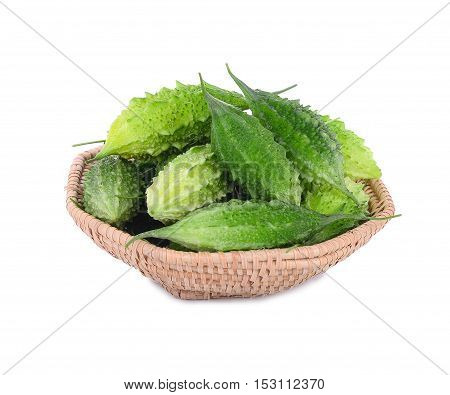 fresh balsam apple balsam pear bitter cucumber bitter gourd bitter melon in wooden basket isolated on white