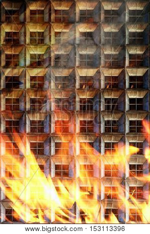 Apartment fire with flames coming up to the windows.