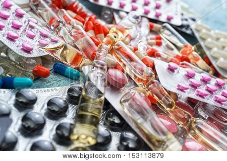 Pharmacy theme, Pharmaceutical medicament for health. Drug ampules prescription for treatment medication. Heap of red orange white round capsule in stick pills with medicine antibiotic in packages poster