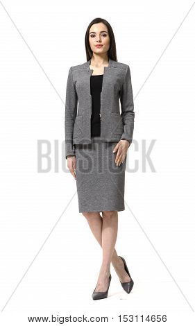 woman with straight hair style in gray skirt power suit high heels shoes full length body portrait standing isolated on white