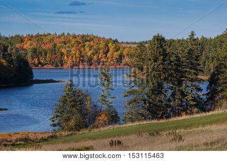 Fall foliage along a river in rural Prince Edward Island, Canada.
