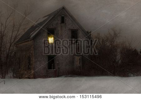 Haunted house in a cold winter field.  Texture effects applied.