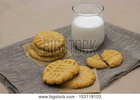 Healthy cookies from the peanut butter with milk on a linen napkin