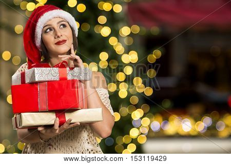 Dreaming Thinking Happy Pensive Beautyful Woman In Red  Hat Santa Claus / Gifts, Christmas, X-mas Co