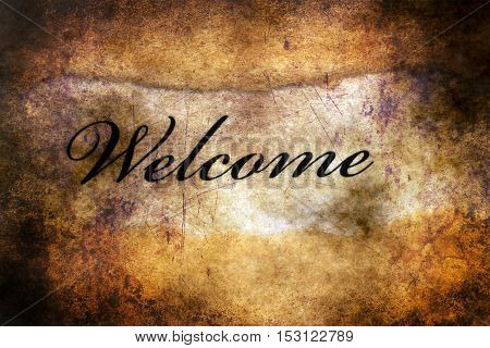 Welcome text on ripped grunge background concept