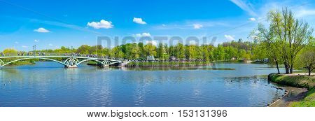 MOSCOW RUSSIA - MAY 10 2015: Tsaritsyno Park is famous recreation center with cascade of ponds decorative bridges islands lush greenery alcoves on May 10 in Moscow.