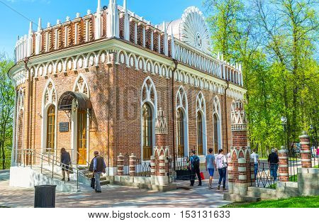 MOSCOW RUSSIA - MAY 10 2015: The tourists visit Small Palace (Semicircular Palace) of Imperial Residence in Tsaritsyno the perfect place to enjoy beauty of nature and splendor of architecture on May 10 in Moscow.