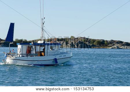 one small fishingboat on the swedish westcoast going out and fish