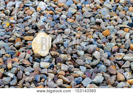 gravel aggregate rocks on ground abstract background .