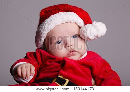 photo of cute baby with santa costume