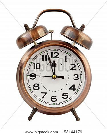 Retro the alarm clock of bronze color at twelve o'clock isolated on a white background. Midnight midday. Minutes about New year.