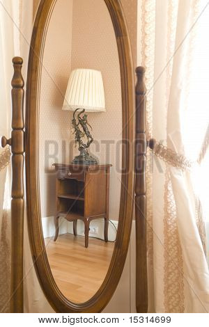 furniture reflected in a mirror in living room