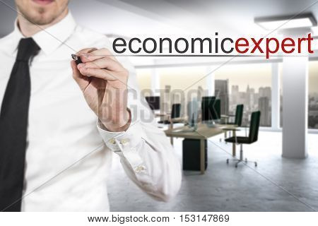 businessman in modern office writing economic expert in the air