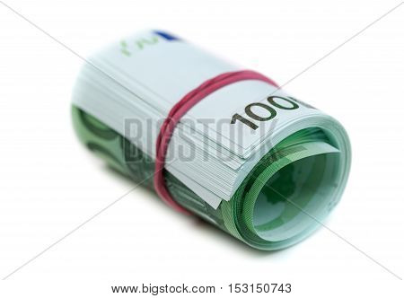 One hundred euro banknotes roll with rubber isolated on white background