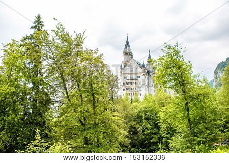 Hohenschwangau, Germany - July 02, 2016: View on Neuschwanstein castle in Germany. This castle is a nineteenth-century romanesque revival palace on a hill in southwest Bavaria, Germany