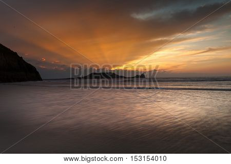 Sunset at Rhossili Bay and Worms Head on the Gower peninsula, South Wales