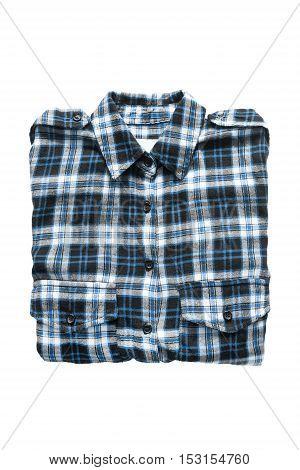 Folded tartan shirt isolated over white background