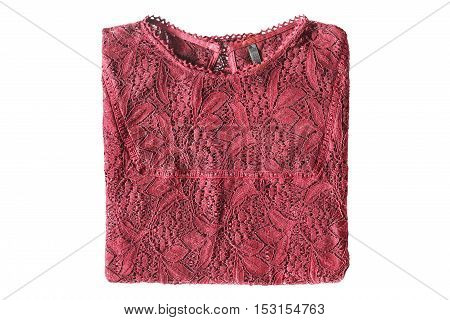 Folded red lacy blouse isolated over white