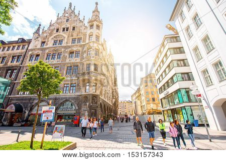 Munich, Germany - July 03, 2016: Tourists walk the street near the town hall in the center of Munich, Germany