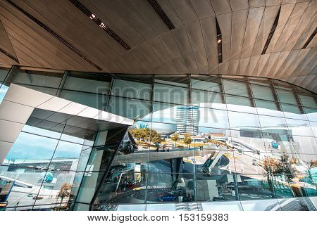 Munich, Germany - July 03, 2016: Facade of BMW world building with the refelction in Munich. BMW World is a multi-use exhibition center used for promotional events, and where buyers take BMW vehicles