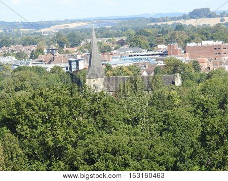 St Marys church, Horsham, West Sussex as viewed from Denne Hill. Hurst Hill & Warnham Landfill in the distance.