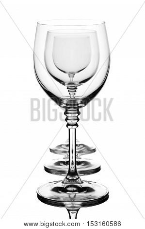close up of three cocktail glasses one after another isolated over white