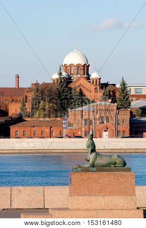Saint - Petersburg, Russia - October 24, 2016: Monument to victims of political repressions (Chemiakin Sphinxes).On the background is Kresty (Crosses) Prison with Orthodox Church of St. Alexander Nevsky