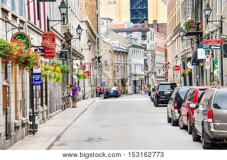 Montreal, Canada - July 26, 2014: Old town street with European style architecture and many restaurants and shops