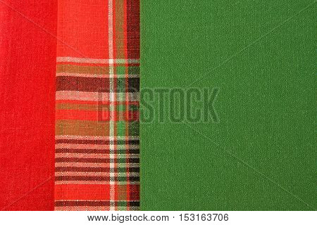 Close up of red checkered and green fabric.