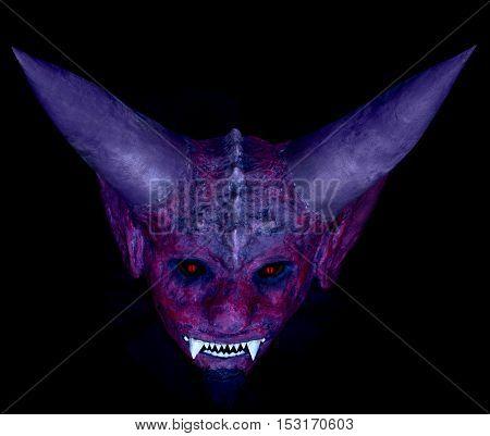devil's head on a black background red devil mask for Halloween