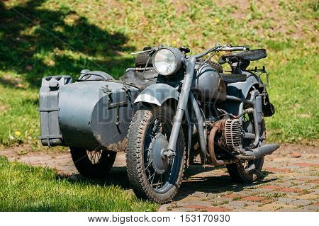 The Old Rarity Tricar, Three-Wheeled Gray Motorcycle With A Sidecar Of German Forces Of World War 2 Time Standing As An Exhibit In Summer Sunny Park.