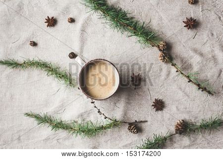 Christmas composition. Cup of coffee larch branches anise star. Christmas background. Flat lay top view