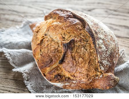 Wholegrain bread on the sackcloth close up