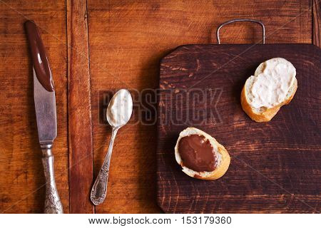 Composition of sweet and savory snacks on the kitchen table