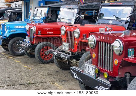 SALENTO COLOMBIA - JUNE 6: Row of Willys jeeps in the plaza of Salento Colombia waiting to take tourists to Cocora Valley on June 6 2016