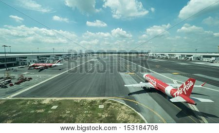 KUALA LUMPUR, MALAYSIA - NOVEMBER 05, 2015: Airplane of Air Asia airline and other planes on flying line in Kuala Lumpur airport